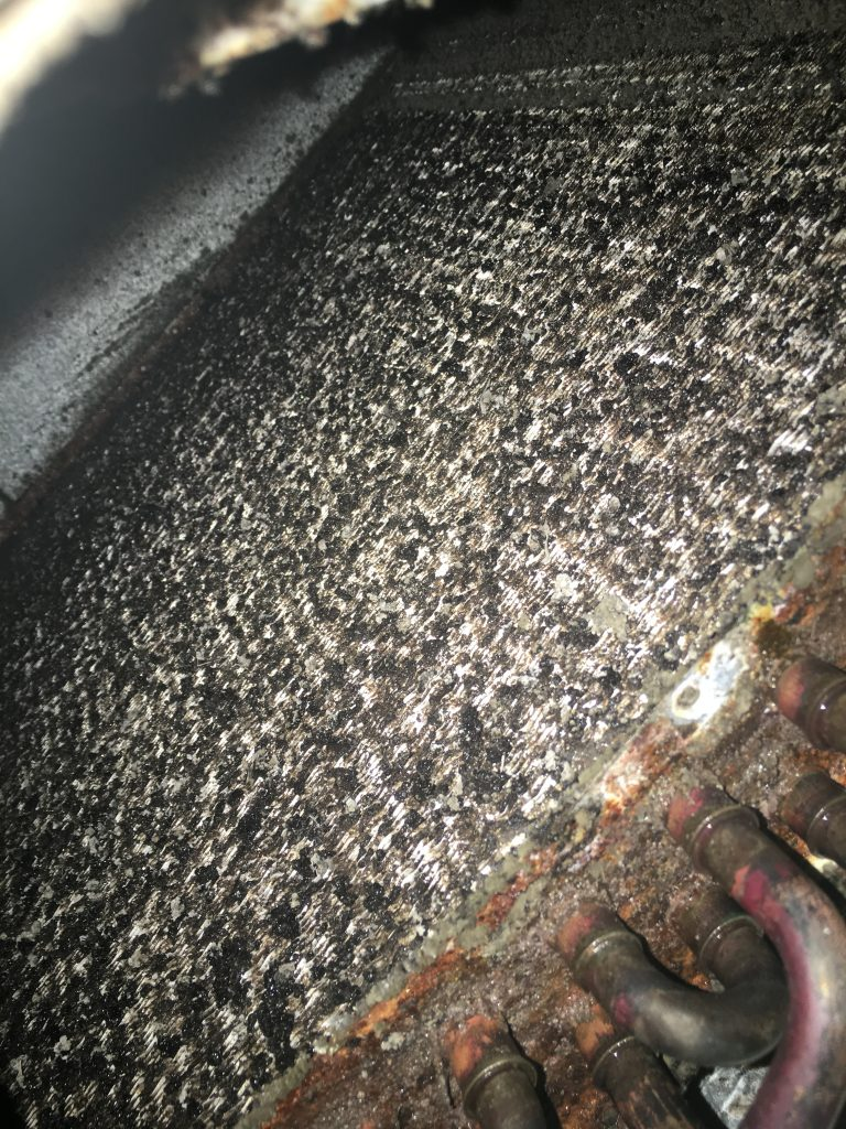 Dirty evaporator coil causing warm air to blow